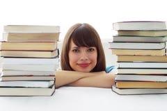 La cara y libros de la muchacha Imágenes de archivo libres de regalías