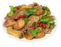 La carne del pollo ha fritto con le bacche del viburno fotografia stock libera da diritti