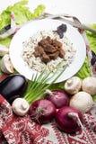 La carne di maiale collega con un contorno da riso sbramato Immagini Stock Libere da Diritti