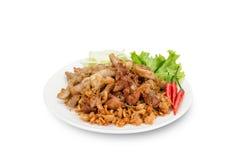 La carne di maiale ha fritto con aglio su fondo bianco, tagliante il picchiettio immagini stock libere da diritti
