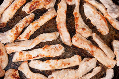 La carne spoglia Fried In una pentola Immagine Stock