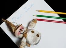 La carta estimado Papá Noel de los niños Fotos de archivo