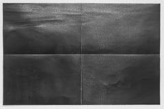 La carta nera piegata in 4 si separa il fondo bianco Fotografia Stock