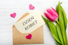 La carte de jour du ` s de femmes avec le polonais exprime DZIEŃ KOBIET Photo stock