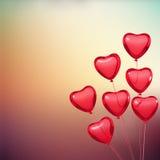 La carte de Valentine avec des ballons de forme de coeur Photographie stock libre de droits