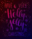 La carte de voeux de Holly Jolly avec Noël calligraphique écrit par main souhaite l'expression Photographie stock libre de droits