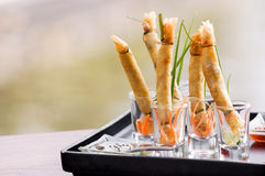 A la carte designed crispy deep-fried spring roll in mini glas. S serve for snack time stock photography