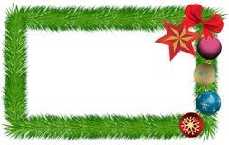 La carte a garni des ornements et du ruban de Noël d'aiguilles de pin Images libres de droits
