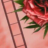 La carte grunge avec le film et le rouge s'est levée Image stock