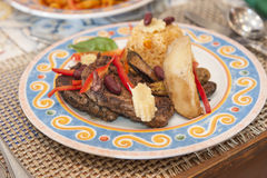 A la carte steak meal on patterned plate Stock Image