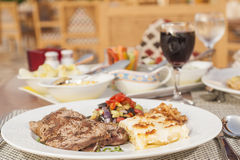 A la carte steak meal on patterned plate Royalty Free Stock Photography