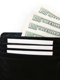 La cartera negra con el paquete de dólares se cierra para arriba fotos de archivo libres de regalías