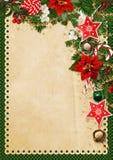 La cartolina d'auguri di Natale con un posto per il testo, con il pino si ramifica, campane, le stelle, la stella di Natale, i do Fotografia Stock