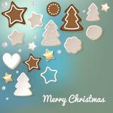 La cartolina di Buon Natale con il pan di zenzero & i biscotti su un bokeh blu-chiaro annebbiano il fondo royalty illustrazione gratis
