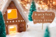 La casa de pan de jengibre, fondo de bronce, Bonne Annee significa Año Nuevo Imagen de archivo