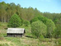 La casa en una madera Fotografía de archivo libre de regalías