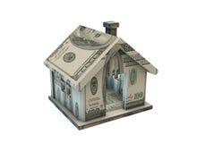 La casa fatta con le banconote del dollaro su bianco Immagini Stock Libere da Diritti
