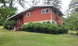 La casa roja grande fotos de archivo libres de regalías