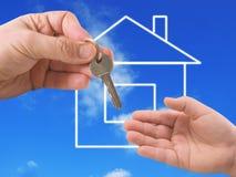 La casa y la mano ilustración del vector
