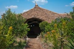 La casetta di lusso ha fatto della canna nel parco nazionale Masai Mara nella regione selvaggia del Kenya fotografia stock libera da diritti