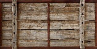 La cassa di legno si imbarca sulla struttura Immagine Stock