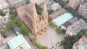 La catedral sagrada del corazón en el abejón de Guangzhou circundó la iglesia católica en un círculo metrajes