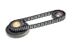 La catena e gli attrezzi per cronometrare il motore isolato su fondo bianco Immagine Stock