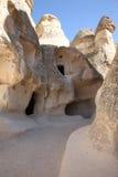 La caverna antica alloggia, in Cappadocia, la Turchia Fotografia Stock Libera da Diritti