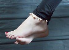 La caviglia delle donne Immagini Stock