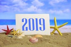 La celebración 2019 en la playa, la Navidad del Año Nuevo del verano vacations Fotografía de archivo