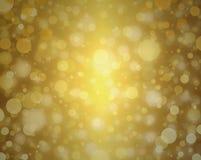 La celebración elegante borrosa de la decoración del fondo de las luces de la Navidad blanca del fondo de la burbuja del oro amari Foto de archivo libre de regalías