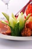 La cena de boda con la carne del rodillo fumó y los tomates Foto de archivo libre de regalías