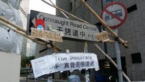La centrale della strada di Connaught in Admirlty vicino alla rivoluzione 2014 dell'ombrello di proteste di Hong Kong del quartie Fotografia Stock Libera da Diritti
