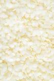 La cera d'api cosmetica bianca appallottola il fondo Immagini Stock Libere da Diritti