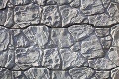 La cerca de la piedra ornamental, fondo del rayo estilizó Fotografía de archivo