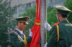 La cerimonia cinese della bandiera nazionale Immagine Stock