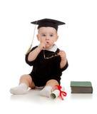 La chéri dans l'académicien vêtx avec le roulis et le livre Photographie stock