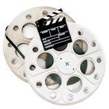 La chapaleta de la película en cine de dos 35 milímetros aspa con la película aislada Imágenes de archivo libres de regalías