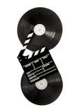 La chapaleta de la película en rollos de película del cine de 35 milímetros aisló vertical Foto de archivo