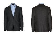 La chaqueta de los hombres con una camisa aislada en blanco imagenes de archivo