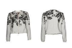 La chaqueta ligera de las mujeres aislada en blanco fotos de archivo