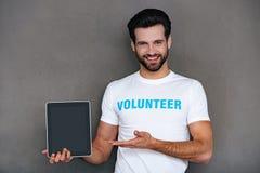 La charité est plus facile avec des technologies Photographie stock libre de droits