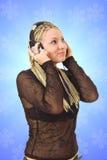 La chica joven con auriculares Fotografía de archivo