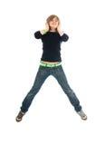 La chica joven con auriculares aislados Foto de archivo libre de regalías