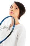 La chica joven con la raqueta de tenis y el bal aisló Fotografía de archivo libre de regalías