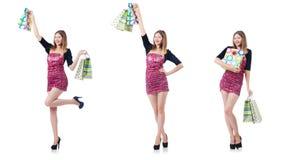 La chica joven después de buen hacer compras en blanco Fotos de archivo