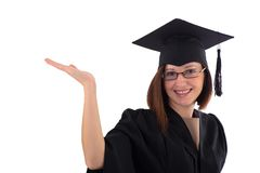 La chica joven en capa del estudiante indica la mano Imagen de archivo libre de regalías