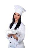 La chica joven en un juego celebra cocinar la bandeja Fotografía de archivo libre de regalías