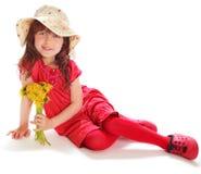 La chica joven en una alineada roja Imágenes de archivo libres de regalías