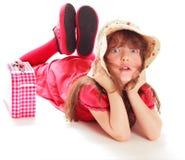 La chica joven en una alineada roja Imagenes de archivo